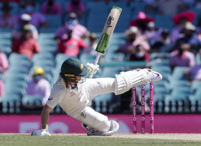 Australia's Will Pucovski falls while batting during play on day three of the third cricket test between India and Australia at the Sydney Cricket Ground, Sydney, Australia, Saturday, Jan. 9, 2021. (AP Photo/Rick Rycroft)