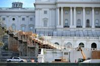 Workers construct the stage for Joe Biden's presidential inauguration at the US Capitol