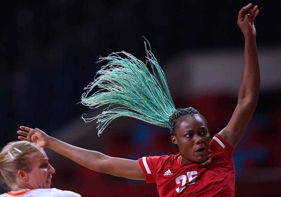 <p>Angola's right back Azenaide Carlos during the women's preliminary round group A handball match between The Netherlands and Angola of the Tokyo 2020 Olympic Games at the Yoyogi National Stadium in Tokyo on July 29, 2021. (Photo by Daniel LEAL-OLIVAS / AFP)</p>