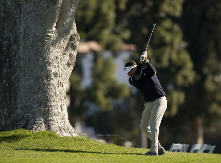 Bubba Watson hits his second shot on the first hole during the Genesis Invitational pro-am golf event at Riviera Country Club, Wednesday, Feb. 17, 2021, in the Pacific Palisades area of Los Angeles. (AP Photo/Ryan Kang)