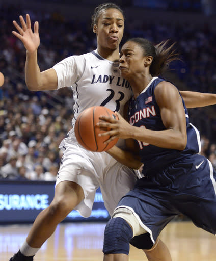 Connecticut's Brianna Banks, right, tries to elude Penn State's Ariel Edwards (23) during the first half of an NCAA college basketball game, Sunday, Nov. 17, 2013, in State College, Pa. (AP Photo/John Beale)