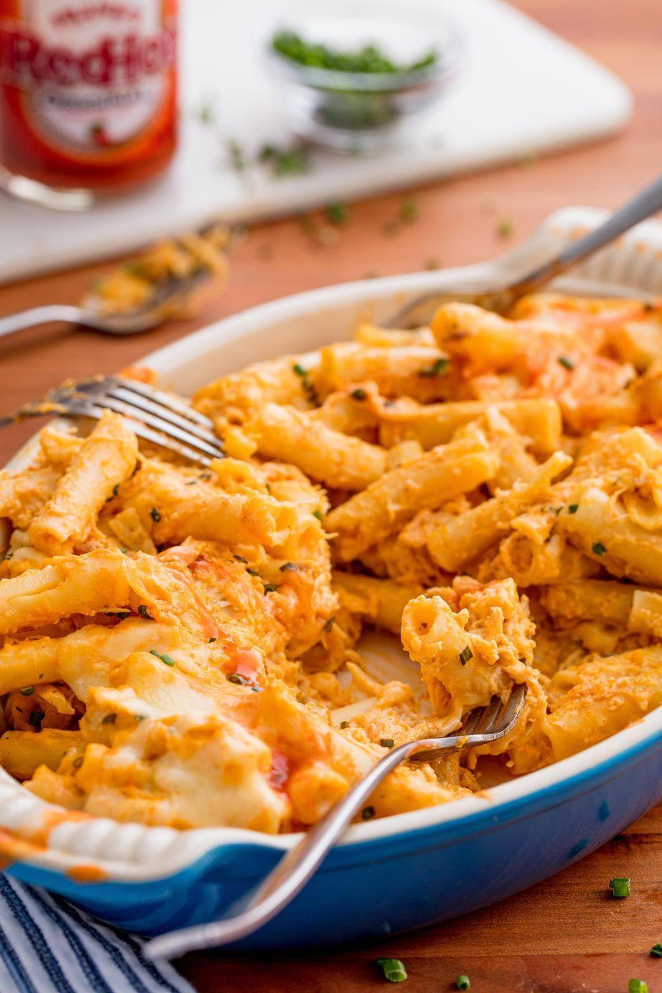 """<p>Buffalo is the pasta sauce you never knew you needed.</p><p>Get the recipe from <a href=""""https://www.delish.com/cooking/recipe-ideas/recipes/a49748/buffalo-baked-ziti-recipe/"""" rel=""""nofollow noopener"""" target=""""_blank"""" data-ylk=""""slk:Delish"""" class=""""link rapid-noclick-resp"""">Delish</a>.</p>"""