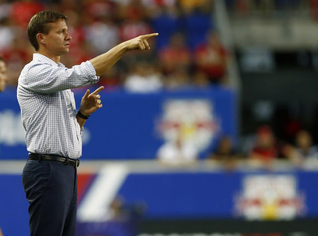 FILE - In this July 26, 2015, file photo, New York Red Bulls manager Jesse Marsch looks on from the sidelines during the first half of a soccer match against SL Benfica in the International Champions Cup in Harrison N.J. Marsch has resigned as coach of Major League Soccer's New York Red Bulls and has been replaced by top assistant Chris Armas, a former U.S. national team defender.The Red Bulls made the announcement on Friday, July 6, 2018. (AP Photo/Rich Schultz, File)