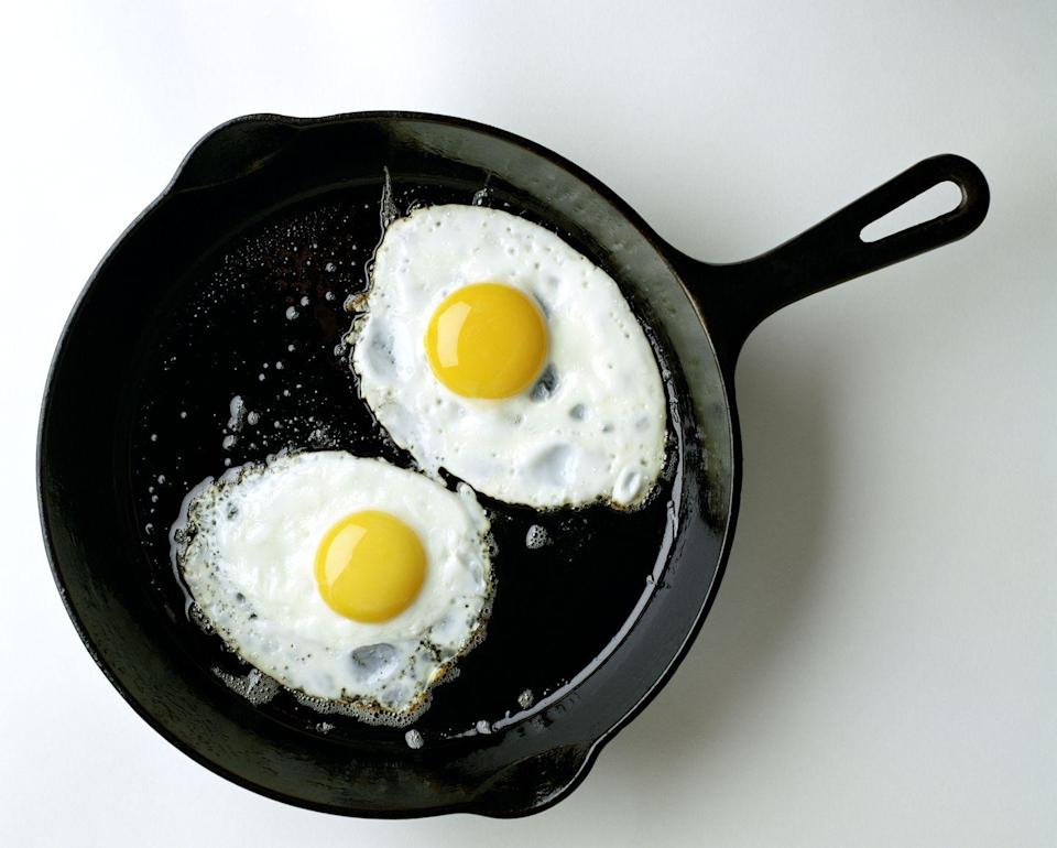 """<p>It's all about the yolks. That's right - the little ball of sunshine inside of one egg holds 41 IU of vitamin D. While eggs have been deemed unhealthy at times over the years, this protein-packed any-time-of-day food has been shown to be a nutritional powerhouse. The American Heart Association points out that all animal products, including eggs, can raise blood cholesterol levels because of their saturated fat content. Consult with your doctor if you need to reduce your LDL (""""bad"""") cholesterol.</p><p><strong>RELATED:</strong> <a href=""""https://www.womansday.com/food-recipes/food-drinks/g2191/egg-recipes/"""" rel=""""nofollow noopener"""" target=""""_blank"""" data-ylk=""""slk:29 Ways to Have Eggs for Every Meal of the Day"""" class=""""link rapid-noclick-resp"""">29 Ways to Have Eggs for Every Meal of the Day</a></p>"""