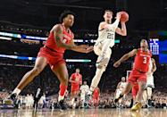 Matt McQuaid #20 of the Michigan State Spartans drives against Kyler Edwards #0 of the Texas Tech Red Raiders during the first half of the semifinal game in the NCAA Men's Final Four at U.S. Bank Stadium on April 06, 2019 in Minneapolis, Minnesota. (Photo by Jamie Schwaberow/NCAA Photos via Getty Images)