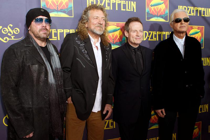 """FILE - This Oct. 9, 2012 file photo shows musicians Jason Bonham, Robert Plant, John Paul Jones and Jimmy Page at the """"Led Zeppelin: Celebration Day"""" premiere at the Ziegfeld Theater in New York. On Monday, Nov. 19, Led Zeppelin's """"Kashmir"""" and """"Since I've Been Loving You"""" will be featured in next week's episode of """"Revolution"""", the same day, Led Zeppelin's """"Celebration Day"""" album and a companion documentary on DVD will be released. The series by J.J. Abrams tells of a world 15 years after the world inexplicably suffers a power outage. (Photo by Dario Cantatore/Invision/AP, file)"""