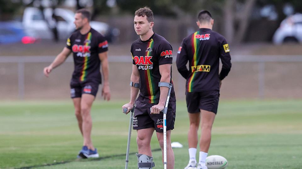 Pictured here, Dylan Edwards on crutches in the lead-up to Sunday night's NRL grand final.