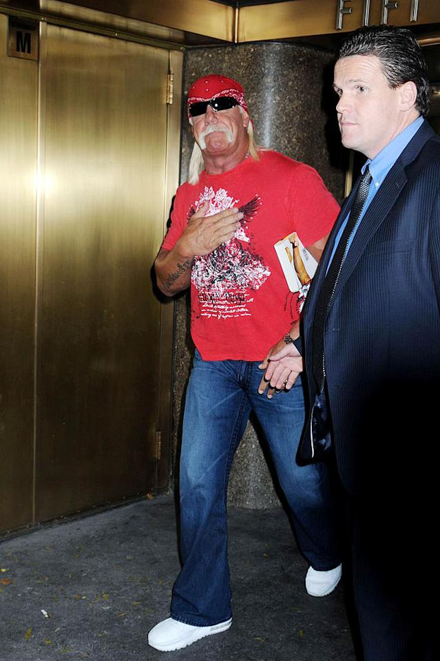 """Hulk Hogan is no stranger to body art. His right arm bears the words """"I am that, I am."""" The wrestler is a lot more verbose in his new book, """"My Life Outside the Ring,"""" which hit stores this week. In it, he describes contemplating suicide in the wake of his divorce and his son's car accident. Darla Khazei/<a href=""""http://www.pacificcoastnews.com/"""" target=""""new"""">PacificCoastNews.com</a> - October 28, 2009"""