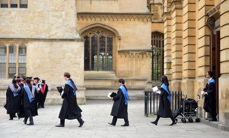 FILE PHOTO: Graduates leave the Sheldonian Theatre after a graduation ceremony at Oxford University, in Oxford, Britain July 15, 2017. REUTERS/Hannah McKay/File Photo