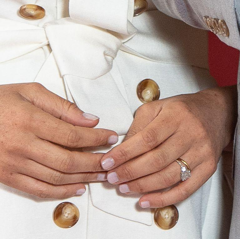 <p>Eagle-eyed fans have noticed that Markle's engagement ring band has been updated. The ring, which was designed by Harry, originally featured a plain gold band, and now its band is decorated with small diamonds. </p><p>Prior to the birth of Archie the Duchess was seen without the engagement ring, fans believed this was due to swelling from the pregnancy, though it now seems this was when the ring was being transformed. </p>