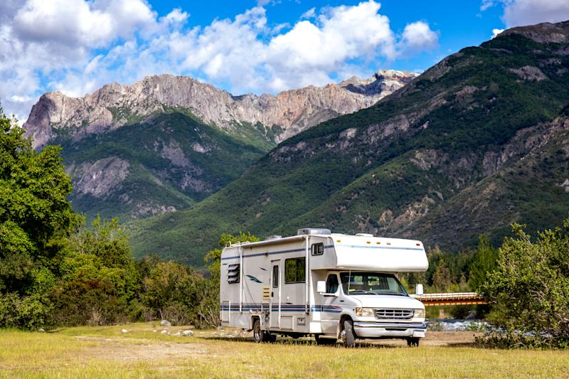 Motorhome in Chilean Argentine mountain Andes. Family trip travel vacation on Motorhome RV in Andes