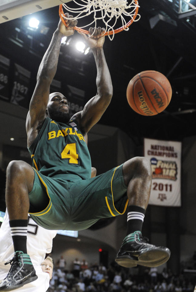 Baylor' Quincy Acy (4) dunks the ball for two points in the second half of an NCAA college basketball game against Texas A&M, Wednesday, Feb. 1, 2012, in College Station, Texas. Baylor won 63-60. (AP Photo/Pat Sullivan)