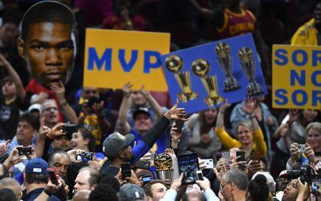 Jun 8, 2018; Cleveland, OH, USA; Golden State Warriors forward Kevin Durant (middle) holds the Bill Russell NBA Finals Most Valuable Player Award after defiant the Cleveland Cavaliers in game four of the 2018 NBA Finals at Quicken Loans Arena. Mandatory Credit: Ken Blaze-USA TODAY Sports