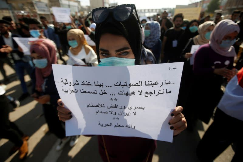 An Iraqi student takes part at an ongoing anti-government protests, in Basra