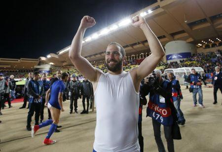 Juventus' Gonzalo Higuain celebrates after the match