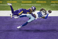 Dallas Cowboys wide receiver CeeDee Lamb (88) catches a second-quarter touchdown pass over Minnesota Vikings cornerback Jeff Gladney (20) during an NFL football game, Sunday, Nov. 22, 2020, in Minneapolis. (Jerry Holt/Star Tribune via AP)