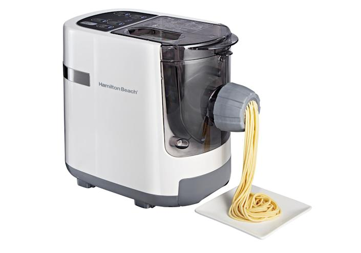 """<p>Noodle novices, this gadget is for you. It automatically mixes the dough and forms it into one of seven pasta shapes — no rolling or drying required. </p> <p><strong>Buy it!</strong> $110; <a href=""""https://goto.walmart.com/c/249354/565706/9383?subId1=PEOIntroducingPEOPLEsProductsWorththeHypein2021khogan1271StyGal12821774202107I&u=https%3A%2F%2Fwww.walmart.com%2Fip%2FHamilton-Beach-Electric-Pasta-and-Noodle-Maker-Machine-Automatic-7-Pasta-Shapes-White-Model-86650%2F997397188"""" rel=""""sponsored noopener"""" target=""""_blank"""" data-ylk=""""slk:walmart.com"""" class=""""link rapid-noclick-resp"""">walmart.com</a></p>"""