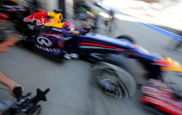Red Bull driver Sebastian Vettel of Germany steers his car out of his team garage during the second practice session for the Korean Formula One Grand Prix at the Korean International Circuit in Yeongam, South Korea, Friday, Oct. 4, 2013.(AP Photo/Aaron Favila)