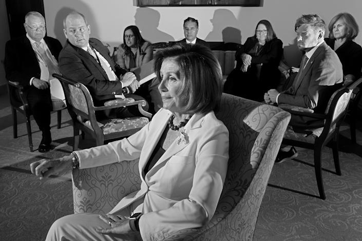 Pelosi meets with her staff on Capitol Hill on December 5. | Philip Montgomery for TIME