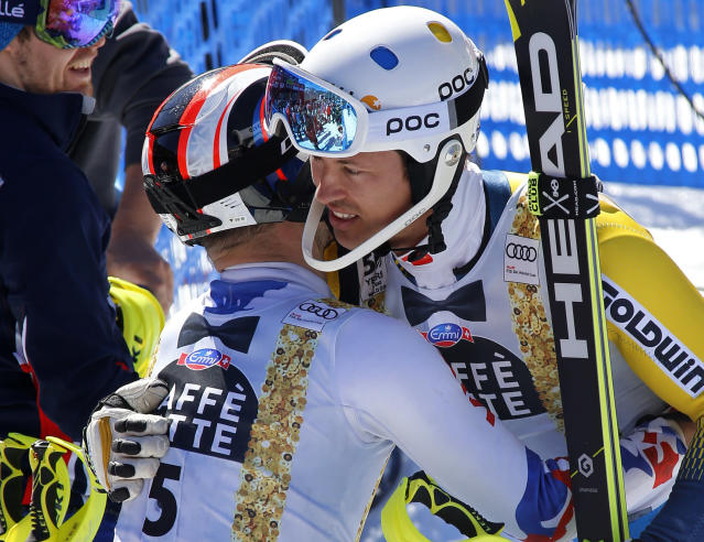 Russia's Alexander Khoroshilov, left, hugs Sweden's Andre Myhrer after the second run of a men's World Cup slalom ski race Sunday, March 19, 2017, in Aspen, Colo. (AP Photo/Nathan Bilow)