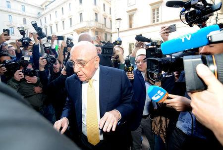 Adriano Galliani arrives at a notary's office for the transfer of ownership of AC Milan from Silvio Berlusconi's Fininvest to China's Li Yonghong in Milan