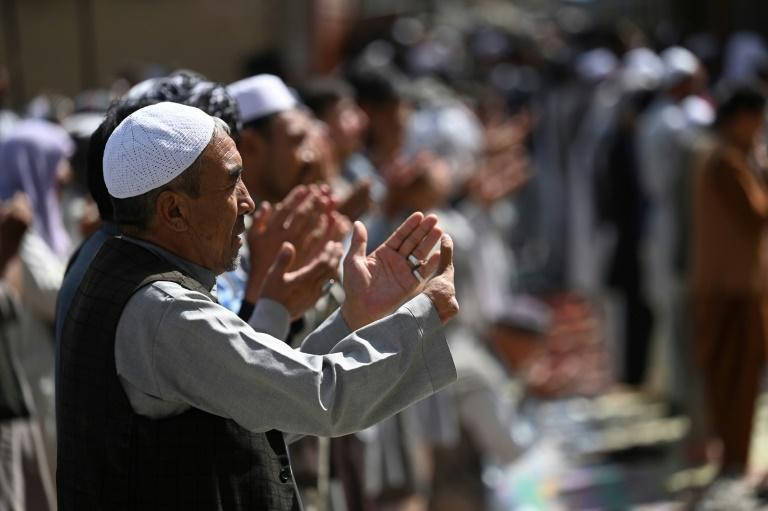 Members of the Hazara community take part in Friday prayers at a mosque on the outskirts of the Afghan capital Kabul on September 10, 2021 (AFP/Aamir QURESHI)