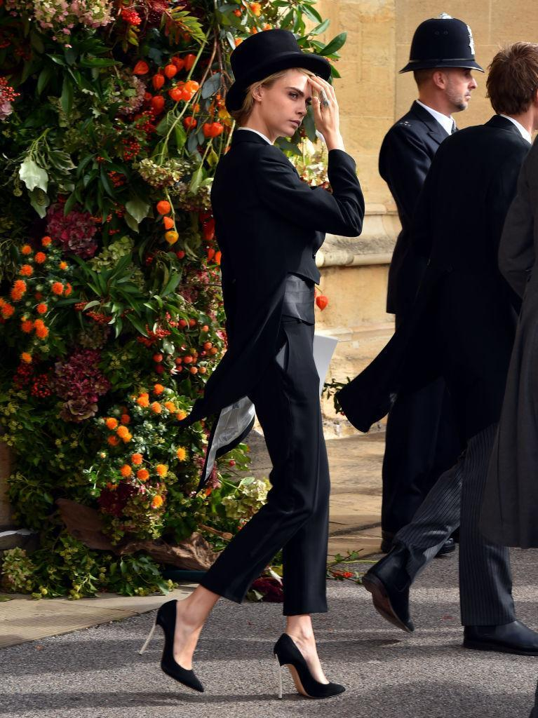 <p>Model Cara Delevingne wins our best dressed list this month thanks to her royal wedding ensemble on October 12. Who needs a fascinator anyway? <em>[Photo: Getty]</em> </p>