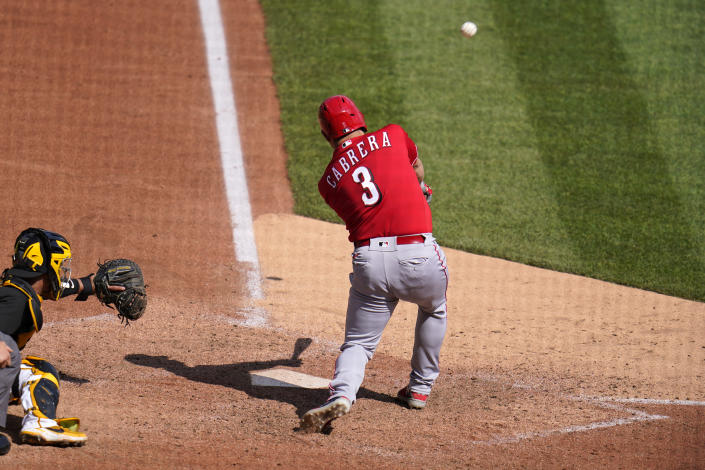 Cincinnati Reds' Asdrubal Cabrera (3) hits a sacrifice fly, driving in a run off Pittsburgh Pirates starting pitcher Cody Ponce, during the seventh inning of a baseball game in Pittsburgh, Thursday, Sept. 16, 2021. (AP Photo/Gene J. Puskar)
