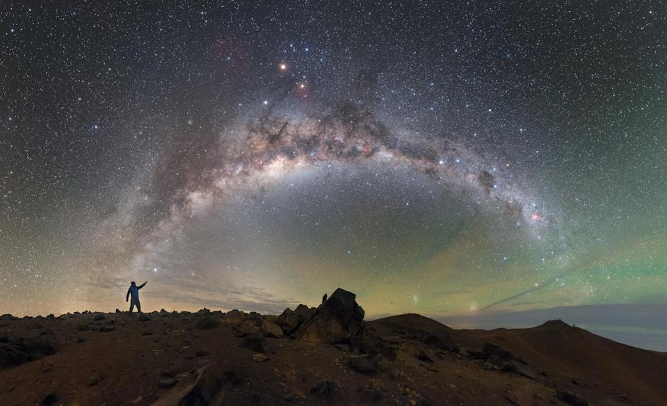<p>The skies above ESO's Paranal Observatory resemble oil on water as greens, yellows and blues blend to create an iridescent skyscape. The rocky, barren landscape below evokes an alien world, complementing the cosmic display above. This photo was given an Honorable mention in the Astronomy category. (PA) </p>