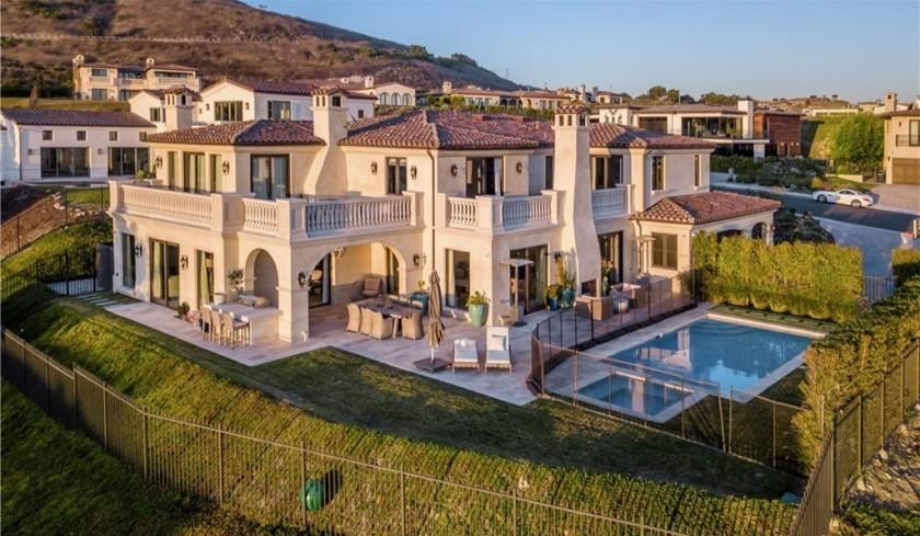 """Custom-built in 2016, the two-story villa takes in sweeping ocean and golf course views from multiple balconies and an entertainer's backyard. <span class=""""copyright"""">(Realtor.com)</span>"""