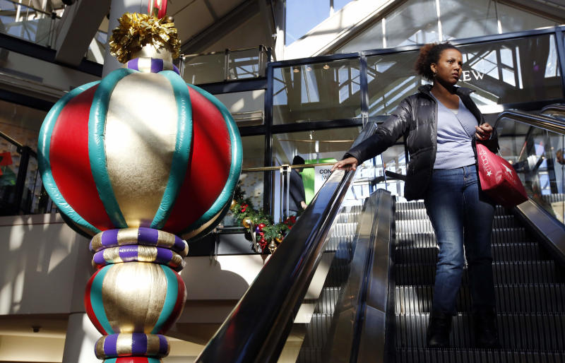 "A woman rides the escalator past a giant holiday ornament at the CambridgeSide Galleria mall in Cambridge, Mass., Monday, Dec. 24, 2012. Although fresh data on the holiday shopping season is expected in coming days, early figures point to a ho-hum season for retailers despite last-ditch efforts to lure shoppers over the final weekend before Christmas. And with concerns about the economy and the looming ""fiscal cliff"" weighing on the minds of already cautious shoppers, analyst say stores will need to offer ""once in a lifetime"" blowouts to clear out inventory.  (AP Photo/Michael Dwyer)"