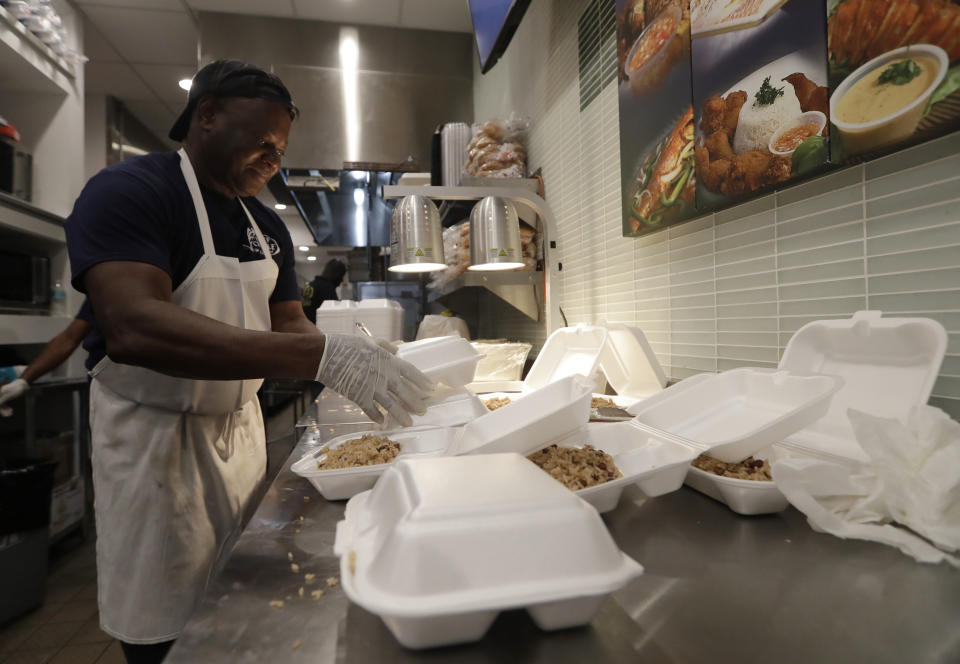 Tony Mertin packages hot meals at the Chef Creole restaurant at Miami International Airport, Tuesday, Jan. 15, 2019, in Miami. The restaurant is offering free lunch and dinner to federal airport employees, one of the acts of kindness for federal workers. (Photo: AP Photo/Lynne Sladky)