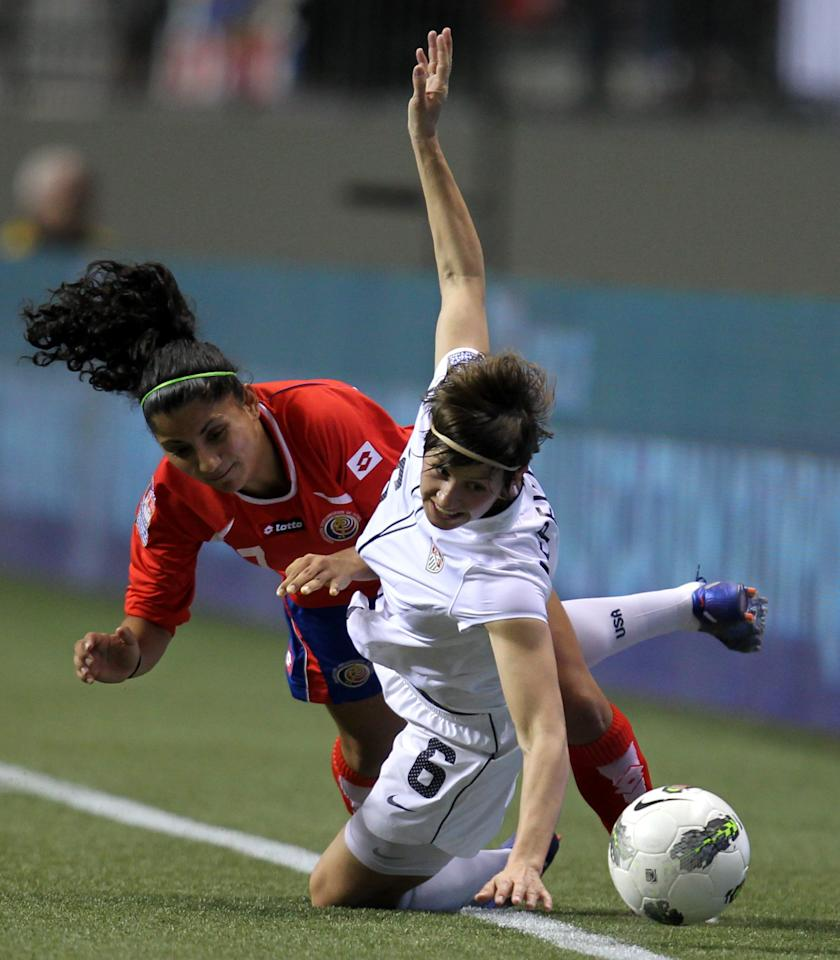 United States' Amy Lepeilbet (6) fights for control of the ball with Costa Rica's Mariela Campos (7) during the first half of CONCACAF women's Olympic qualifying soccer game action at B.C. Place in Vancouver, British Columbia, Friday, Jan. 27, 2012. (AP Photo/The Canadian Press, Jonathan Hayward)