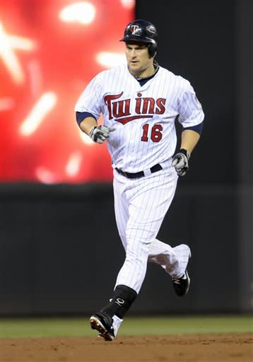 Minnesota Twins' Josh Willingham rounds the bases on his solo home run off Kansas City Royals starting pitcher Luis Mendoza in the first inning of a baseball game, Thursday, Sept. 13, 2012, in Minneapolis. (AP Photo/Jim Mone)