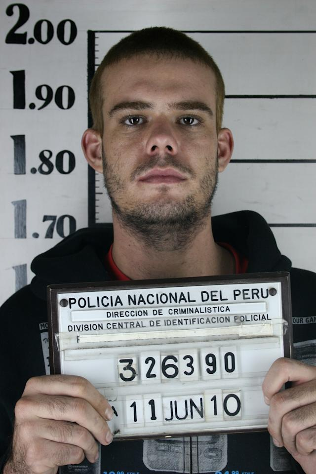 FILE - In this file photo taken June 11, 2010 and obtained by The Associated Press via Peru's America Television channel, Dutch citizen Joran van der Sloot holds his inmate number before been transferred to the Miguel Castro Castro prison in Lima. Under an agreement signed Thursday, May 12, 2011 Dutch murder suspect Joran van der Sloot could serve part of his sentence in the Netherlands if he is convicted of murdering a Peruvian student nearly a year ago. The foreign ministers of the two countries agreed that Dutch prisoners in Peru and Peruvians jailed in the Netherlands can apply to complete their prison terms in their homeland once their appeal process has been completed.