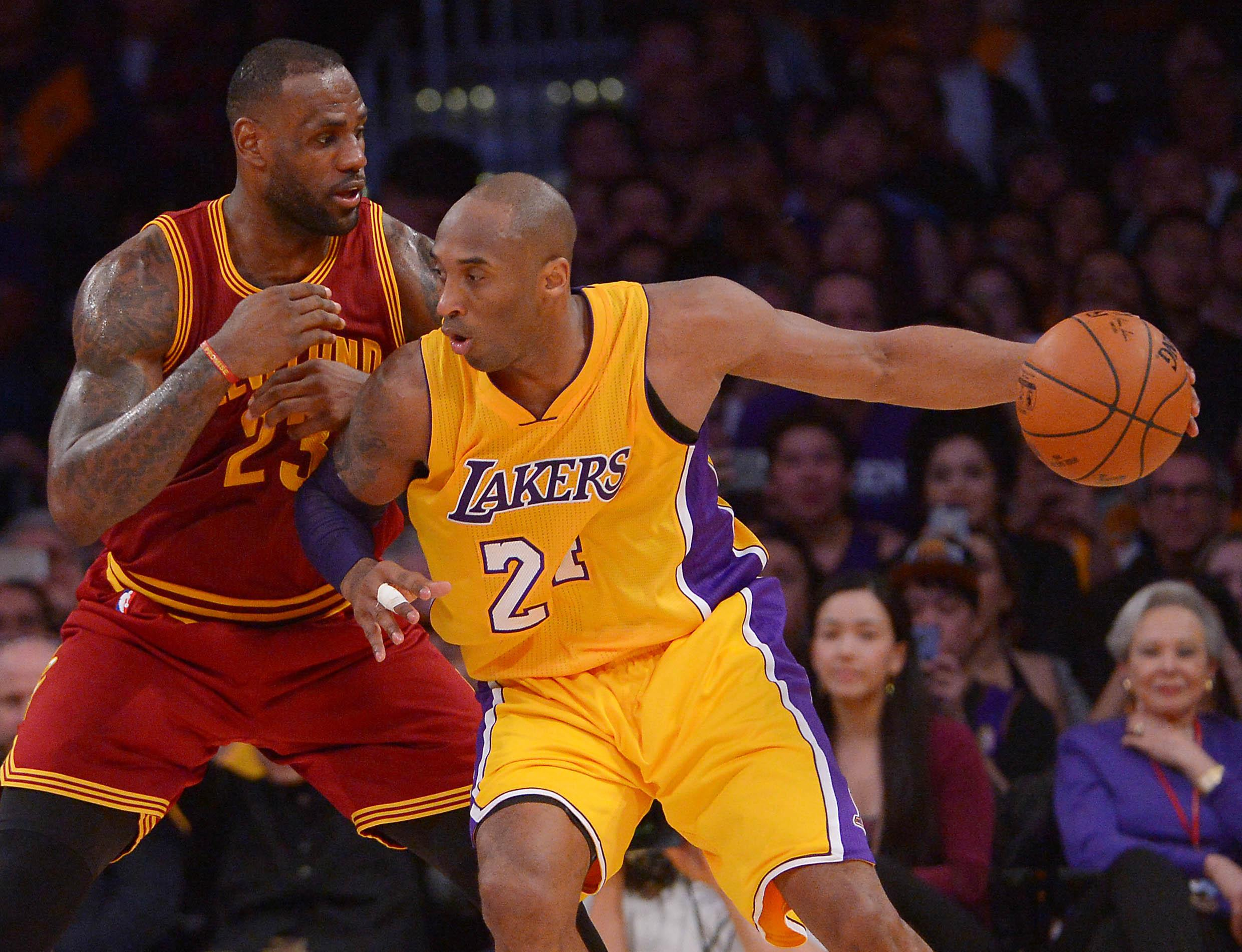 Mar 10, 2016; Los Angeles, CA, USA; Cleveland Cavaliers forward LeBron James (23) guards Los Angeles Lakers forward Kobe Bryant (24) on the court in the first half of the game at Staples Center. Mandatory Credit: Jayne Kamin-Oncea-USA TODAY Sports