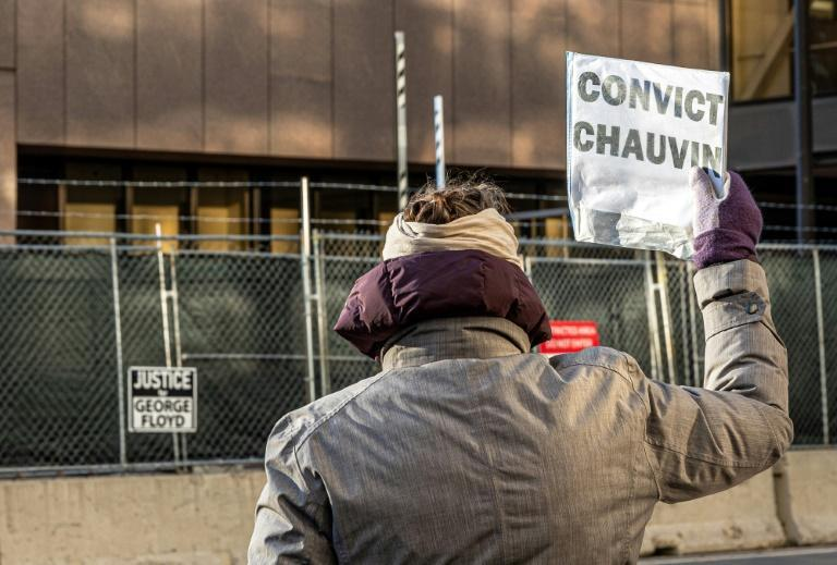 A woman protests outside the trial of former police officer Derek Chauvin