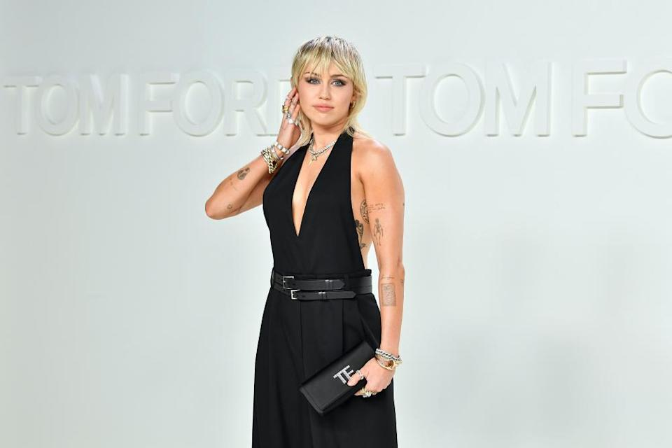 Miley Cyrus shows off her mullet.