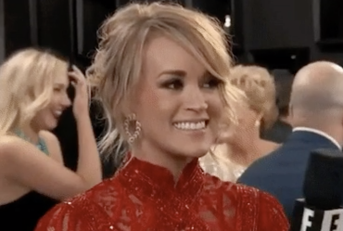 """Carrie Underwood being interviewed by """"E!"""" on the red carpet"""
