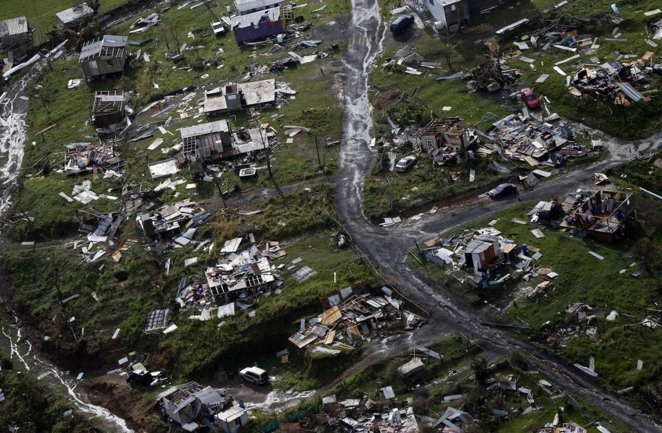 """<span class=""""caption"""">About one-third of homes in Puerto Rico were damaged or destroyed by Hurricane Maria in 2017.</span> <span class=""""attribution""""><span class=""""source"""">(AP Photo/Gerald Herbert)</span></span>"""