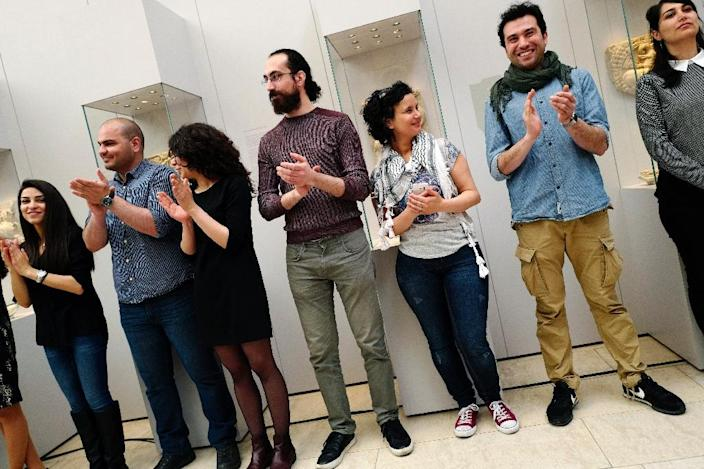 Refugees turned museum guides from Syria and Iraq have been hired at some of Berlin's top museums (AFP Photo/John Macdougall)