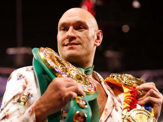 Fury poses with his belts (Reuters)