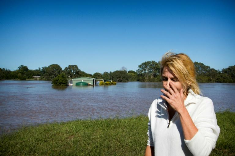 Cassey Bentley reacts after seeing her flooded home in Australia's North MacLean, Brisbane