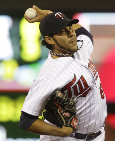 Minnesota Twins pitcher Pedro Hernandez throws against the Cleveland Indians in the first inning of a baseball game on Friday, Sept. 27, 2013, in Minneapolis. (AP Photo/Jim Mone)