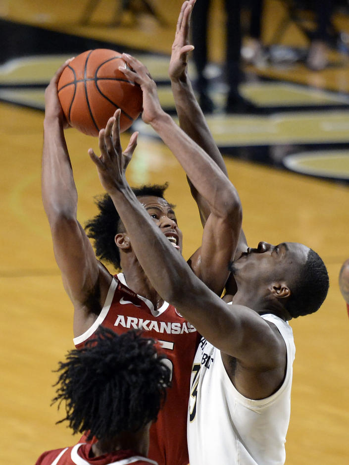 Arkansas guard Moses Moody, left, goes to the basket as Vanderbilt forward Clevon Brown (15) defends during the second half of an NCAA college basketball game, Saturday, Jan. 23, 2021, in Nashville, Tenn. Arkansas won 92-71. (AP Photo/Mark Zaleski)