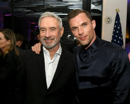 Director Roland Emmerich (L) and actor/rapper Ed Skrein pose after the  premiere of Lionsgate's war drama 'Midway' on November 05, 2019 in Westwood, California