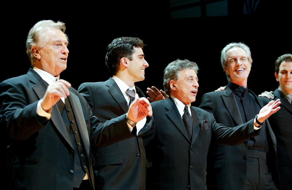 """Tommy DeVito, actor John Lloyd Young, singers Frankie Valli and Bob Gaudio of Frankie Valli and the Four Seasons onstage during the curtain call at the play opening night of """"Jersey Boys"""" at the August Wilson Theater November 6, 2005 in New York City.  (Photo by Paul Hawthorne/Getty Images)"""