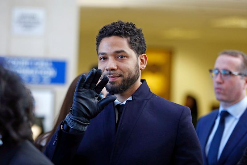 Jussie Smollett waves after his court appearance at Leighton Courthouse in Chicago on Tuesday. (Photo by Nuccio DiNuzzo/Getty Images)