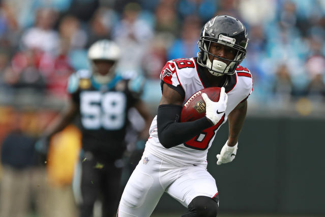 Atlanta Falcons' Calvin Ridley (18) runs for a touchdown after a catch against the Carolina Panthers during the second half of an NFL football game in Charlotte, N.C., Sunday, Dec. 23, 2018. (AP Photo/Jason E. Miczek)