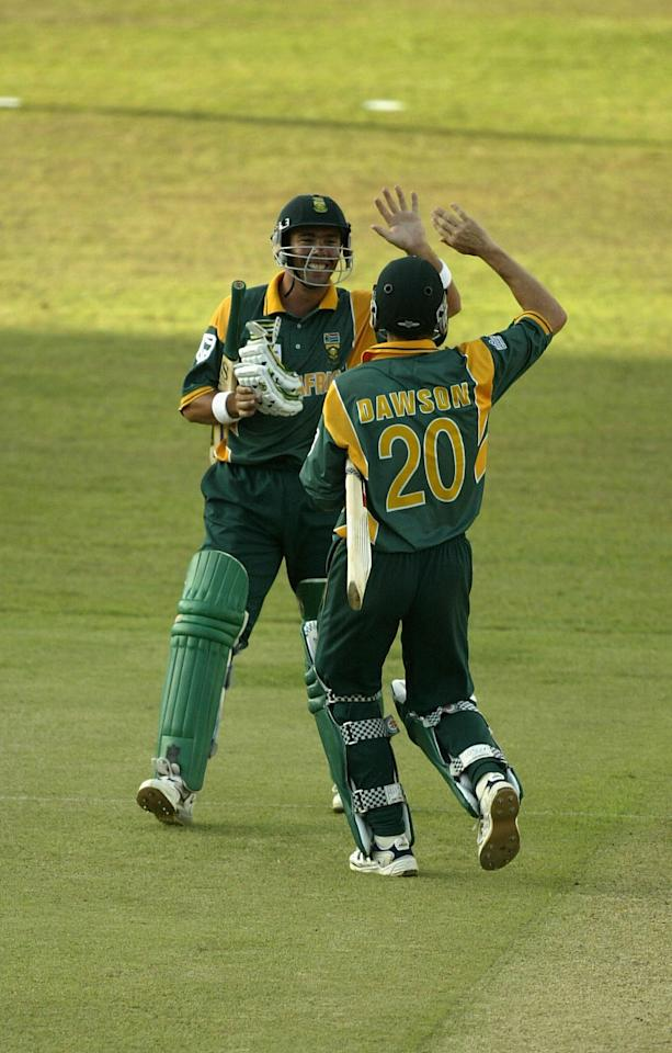 COLOMBO - SEPTEMBER 13:  Alan Dawson and Nicky Boje of South Africa celebrate victory over the West Indies during the ICC Champions Trophy match between South Africa and West Indies at the SSC Stadium in Colombo, Sri Lanka  on September 13, 2002. (Photo by Clive Mason/Getty Images.)